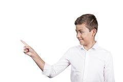 Adolescente feliz que señala en el espacio en blanco de la copia Foto de archivo libre de regalías
