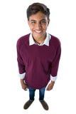 Adolescente feliz que se opone al fondo blanco Fotografía de archivo libre de regalías