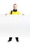 Adolescente feliz que sostiene una bandera en blanco Imagen de archivo libre de regalías