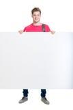 Adolescente feliz que sostiene una bandera en blanco aislada en blanco Fotos de archivo libres de regalías