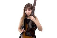 Adolescente feliz que sostiene una guitarra Foto de archivo