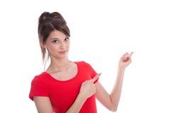 Adolescente femenino aislado que señala con el finger. Imagenes de archivo