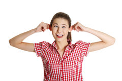 Adolescente femenino alegre haciendo una cara. Imágenes de archivo libres de regalías