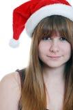 Adolescente femenino con el sombrero de santa Fotografía de archivo