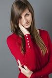 Adolescente femenino con la cara conmovedora de la mano para el reaseguro Imagen de archivo libre de regalías
