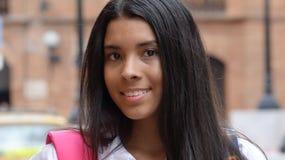 Adolescente femenino con la mochila Fotos de archivo