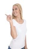 Adolescente femenino feliz aislado que presenta con su finger sobre w Imagen de archivo libre de regalías