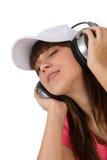 Adolescente femenino feliz con los auriculares Imagen de archivo libre de regalías