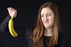 Adolescente disgustado con bananna Imagenes de archivo