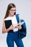 Adolescente femenino que usa la tableta Foto de archivo libre de regalías
