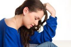 Adolescente femenino tensionado Fotografía de archivo