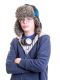 Adolescente fresco con el sombrero del trampero Imagen de archivo libre de regalías