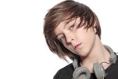Adolescente fresco con los auriculares Imagenes de archivo