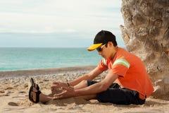 Adolescente fresco en la playa Fotografía de archivo