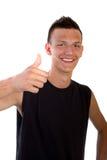 Adolescente fresco joven con los pulgares para arriba Imagenes de archivo