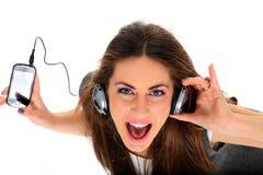 Adolescente fresco que escucha la música y el baile Imágenes de archivo libres de regalías