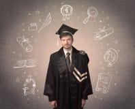 Adolescente graduado feliz con los iconos dibujados mano de la escuela Fotos de archivo libres de regalías