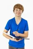 Adolescente hermoso con el azul Foto de archivo libre de regalías