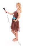Adolescente hermoso con el micrófono Foto de archivo