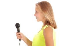 Adolescente hermoso con el micrófono Imagen de archivo libre de regalías