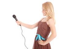 Adolescente hermoso con el micrófono Fotografía de archivo