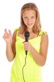 Adolescente hermoso con el micrófono Imagen de archivo