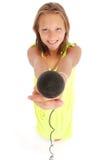 Adolescente hermoso con el micrófono Fotografía de archivo libre de regalías