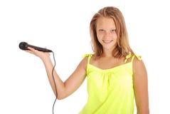Adolescente hermoso con el micrófono Imágenes de archivo libres de regalías