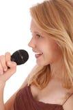 Adolescente hermoso con el micrófono Fotos de archivo libres de regalías
