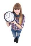 Adolescente hermoso con el reloj aislado en blanco Foto de archivo