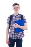Adolescente hermoso con la mochila y el libro aislados en blanco Fotografía de archivo
