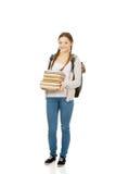 Adolescente hermoso con la mochila y los libros Imagen de archivo libre de regalías