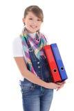 Adolescente hermoso con las carpetas sobre blanco Imagen de archivo libre de regalías