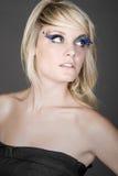 Adolescente hermoso con las pestañas de la pluma Foto de archivo