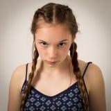 Adolescente hermoso con las trenzas y Onesie Fotografía de archivo