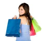 Adolescente hermoso con los bolsos de compras Fotografía de archivo