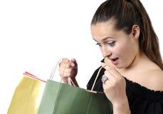 Adolescente hermoso con los bolsos de compras Imagen de archivo libre de regalías