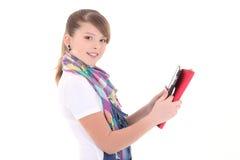 Adolescente hermoso con PC de la tablilla sobre blanco Foto de archivo