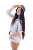Adolescente hermoso en dril de algodón con el casquillo Imagen de archivo