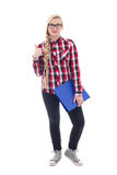 Adolescente hermoso en lentes con el libro en su pulgar de la mano Fotografía de archivo libre de regalías