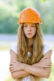 Adolescente hermoso en una naranja Fotografía de archivo libre de regalías