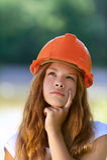 Adolescente hermoso en una naranja Imagenes de archivo