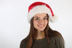 Adolescente hermoso que lleva un sombrero de santa Fotografía de archivo libre de regalías