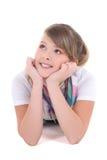 Adolescente hermoso que miente sobre blanco Imagen de archivo libre de regalías