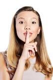 Adolescente hermoso que pide silencio Imagen de archivo libre de regalías