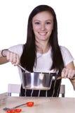 Adolescente hermoso que prepara el alimento Foto de archivo libre de regalías