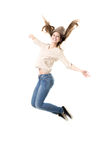 Adolescente hermoso que salta arriba con placer Foto de archivo libre de regalías