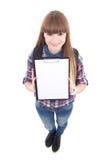 Adolescente hermoso que sostiene el tablero en blanco aislado en blanco Fotografía de archivo libre de regalías