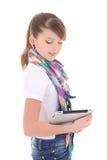 Adolescente hermoso que sostiene la PC de la tablilla sobre blanco Imagen de archivo