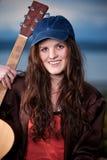 Adolescente hermoso que toca la guitarra Foto de archivo libre de regalías
